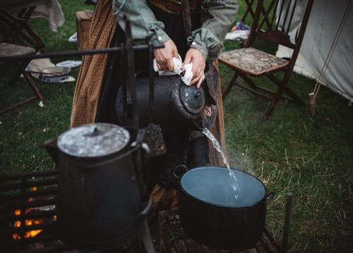 Filling a small pan with water